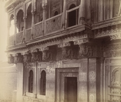 Close view of private house showing details of wood-carving on balcony and supporting brackets, Srigonda.